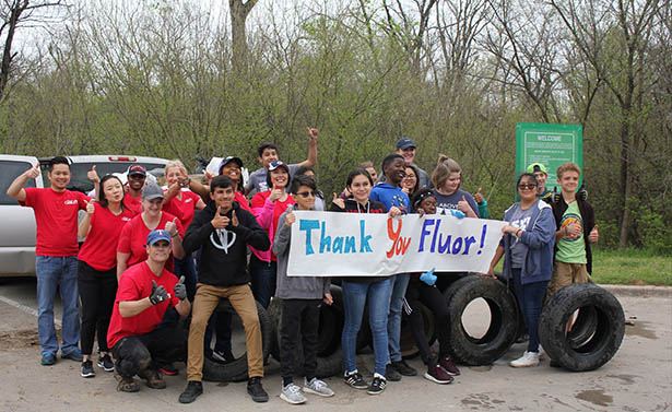 Fluor Cares volunteers proudly display a small portion of trash removed from the Trinity River Audubon Center cleanup in Dallas
