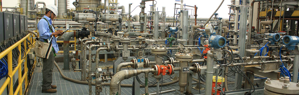 Construction Supervisor Checking Valve Trains at Petrochemical Complex