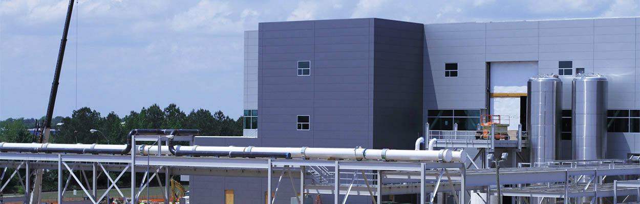 Biotech facility exterior construction - utility services and pipe rack